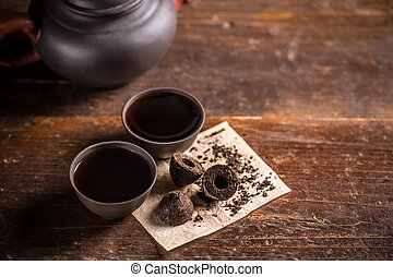 Chinese pu-erh tea - Cups of chinese pu-erh tea on wooden...