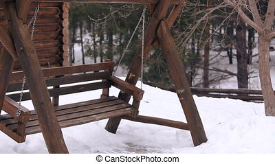wooden swing in the forest winter - Video wooden swing in...