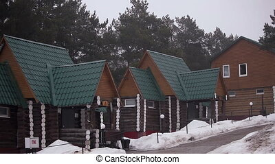 wooden house in the pine forest - Video wooden house in the...