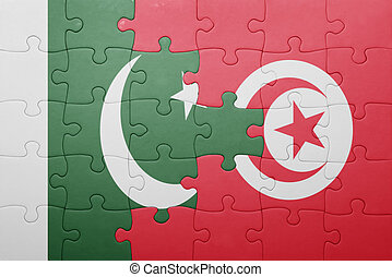 puzzle with the national flag of tunisia and pakistan