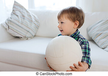 happy little baby boy with ball at home - childhood and...