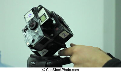 Man Mounting Spherical Camera on the Holder VR gopro 360 -...