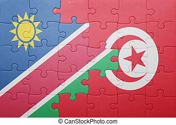 puzzle with the national flag of tunisia and namibia concept...