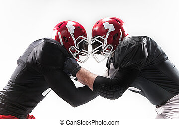 The two american football players fighting on white...