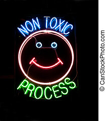 """non toxic\"" neon sign - neon sign on window of dry cleaner"