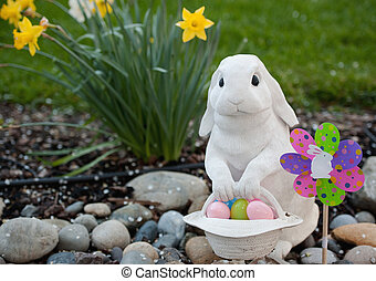 easter rabbit at spring - white rabbit with a basket of...
