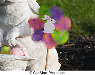pin wheel spinning in the wind - easter eggs, rabbit and...