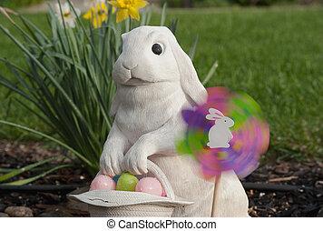 white rabbit holding an easter basket - a pinwheel spinning...