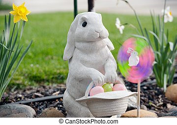 rabbit with spin wheel at easter - a rabbit carries pastel...