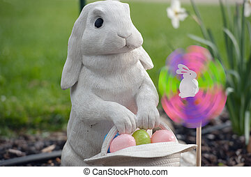 easter bunny with pinwheel - white rabbit carrying a basket...