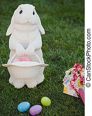 easter rabbit bringing party favors - white rabbit on lawn...