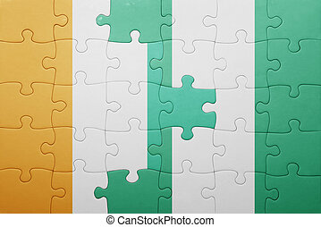 puzzle with the national flag of cote divoire and nigeria...