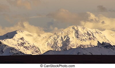 Clouds Roll Over High Peaks Alaska - Tight shot fast motion...