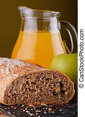 Wholewheat bread with apple and juice - Vertical photo of...