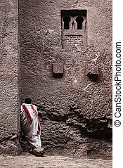 priest at ancient christian orthodox church in lalibela...