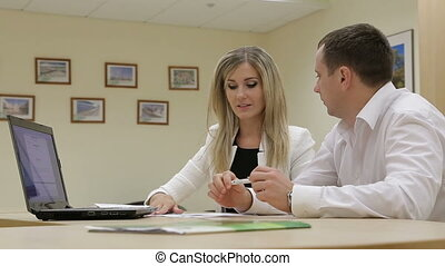 Sales manager talking to client, business presentation on laptop