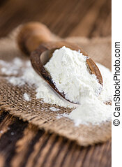 Milk Powder (close-up shot) on an old vintage wooden table...