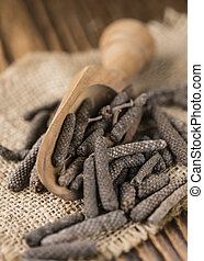 Dried Long Pepper selective focus on vintage wooden...