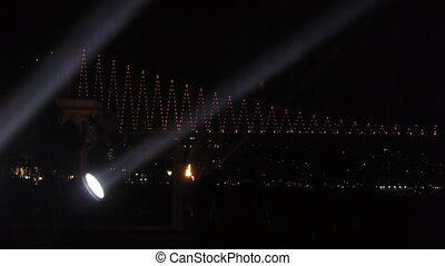 Spotrlights over bridge - Spotlights shine for celebration...
