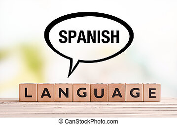 Spanish language lesson sign on a table - Spanish language...