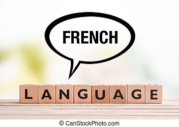 French language lesson sign on a table - French language...