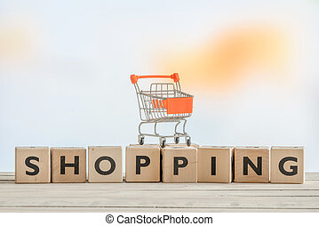 Shopping sign with a orange cart - Wooden shopping sign with...