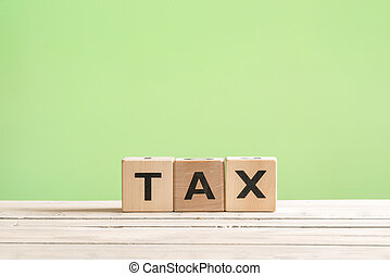 Tax sign on a green background