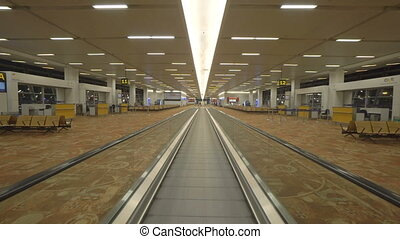 Moving walkway in international airport, Delhi, India -...