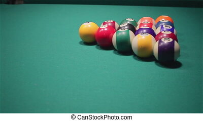 Playing billiard .Close-up shot of a man playing billiard -...