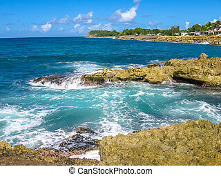Guadeloupe north coast - Rocks and strong waves crashing on...