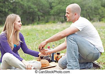 Men make wedding proposal at oudoor