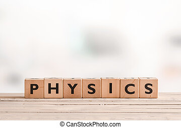 Physics sign on a desk - Physics sign made of solid cubes on...