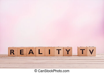Reality TV sign made of wood on a violet background