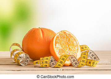 Orange fruit with a yellow measure tape