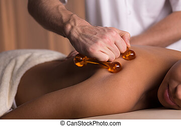 Tough massage with massager - Close-up of physiotherapist...