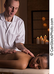 Woman and deep tissue massage - Young relaxed beautiful...