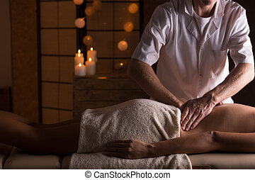 Massage on woman's lumbar spine