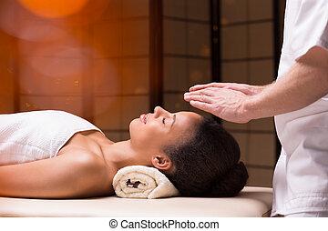 Woman and her bioenergy - Bioenergy therapist holding his...