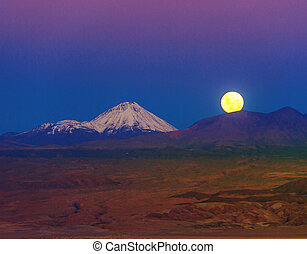 Full-moon in the Moon Valley. Volcanoes Licancabur and Juriques, Atacama, Chile