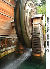 wooden waterwheel is rotating