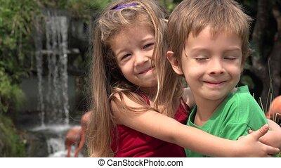 Adorable Toddler Siblings Hugging