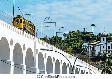 Train drives along distinctive white arches of the landmark...