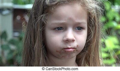 Toddler Girl Eating Chocolate