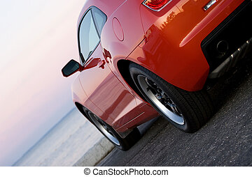 Modern Sports Car - A modern sports car parked at the beach...