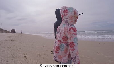 Waiting child by the sea in heavy storm