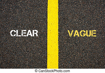 Antonym concept of CLEAR versus VAGUE written over tarmac,...