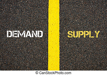 Antonym concept of DEMAND versus SUPPLY written over tarmac,...