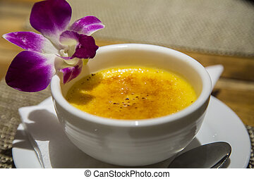 Creme Brulee - creme brulee served with flower