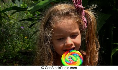 Adorable Child With Candy