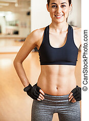 Pretty girl in sporty outfit with abs - Close crop of a...
